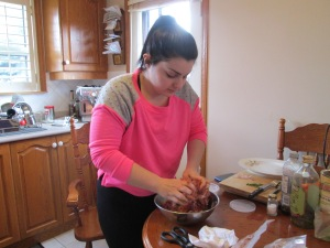 Sabrina mixing meatballs